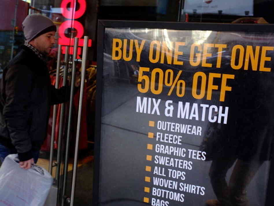 Sign of the times: Markdowns at a discount clothing store in New York City last month. Such stiff competition for consumers' dollars is helping to keep inflation in check.