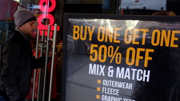 Sign of the times: Markdowns at a discount clothing store in New York City last month. Such stiff competition for consumers' dollars is helping to keep inflation in check. (Getty Images)