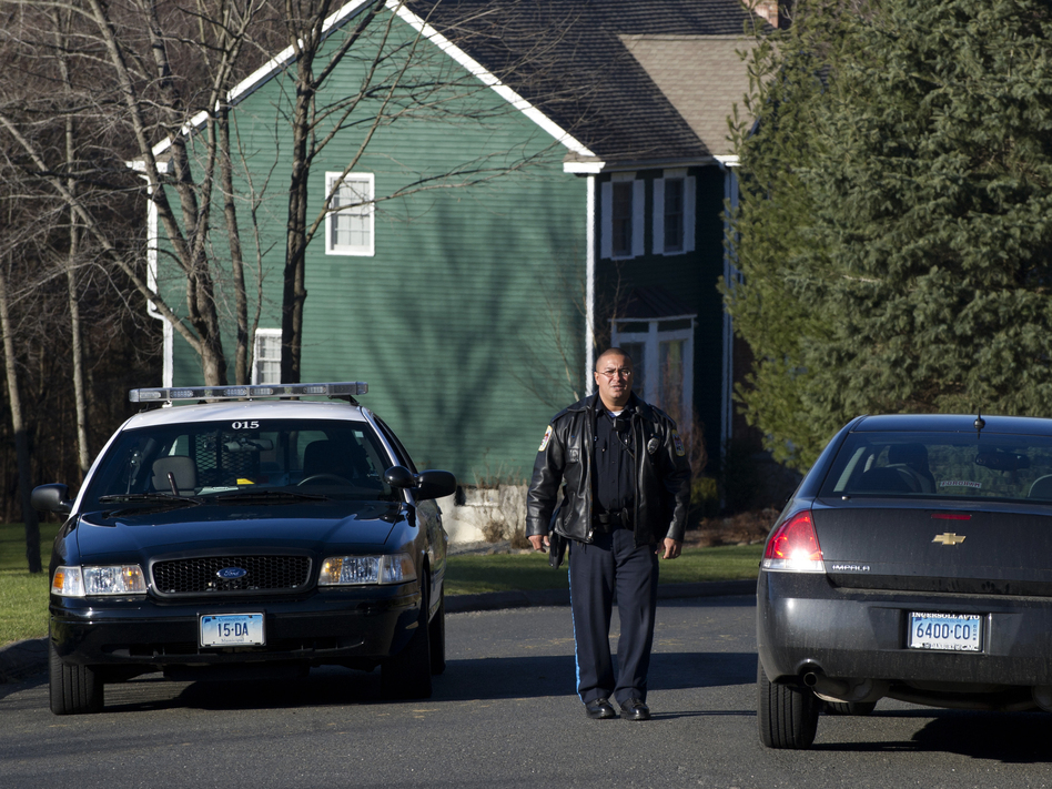 Police block a road near the house of Nancy Lanza in Newtown, Conn., on Saturday. Authorities say Lanza's son Adam killed her before opening fire at Sandy Hook Elementary School on Friday. (AFP/Getty Images)