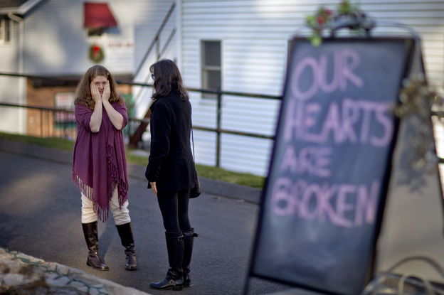 Shop owners Tamara Doherty (left) and Jackie Gaudet meet outside their stores for the first time since becoming neighbors, just down the road from Sandy Hook Elementary School in Newtown, Conn.
