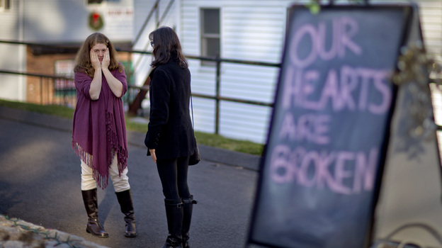 Shop owners Tamara Doherty (left) and Jackie Gaudet meet outside their stores for the first time since becoming neighbors, just down the road from Sandy Hook Elementary School in Newtown, Conn. (AP)