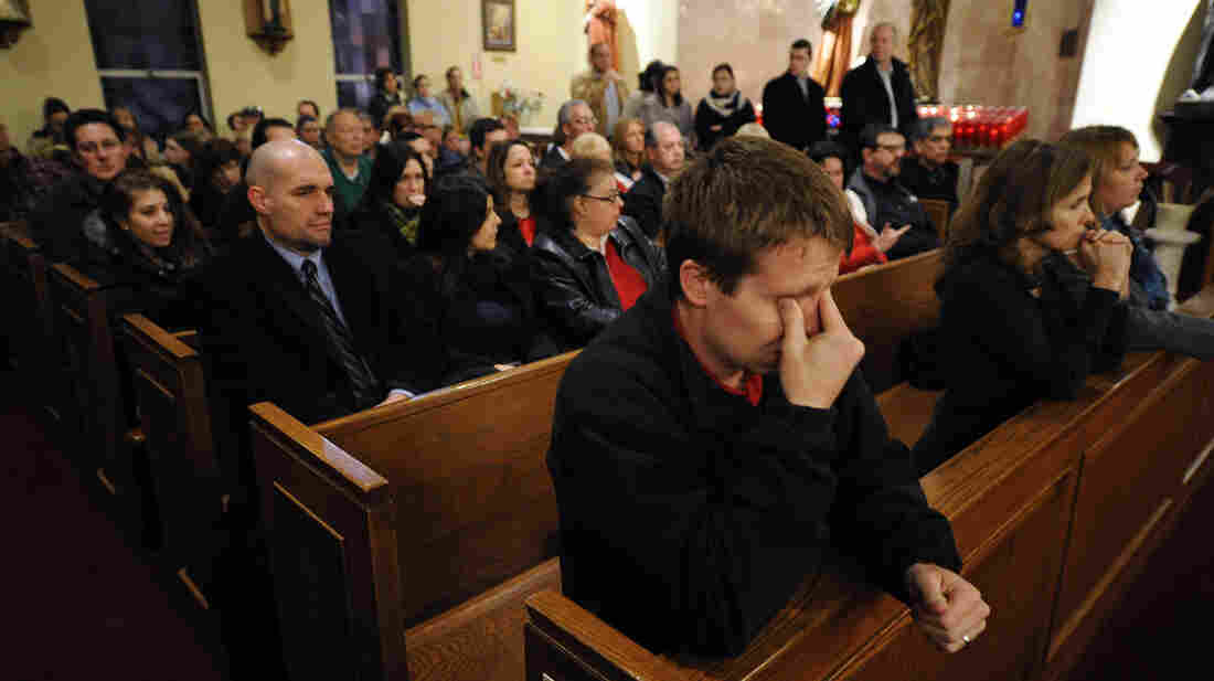 Mourners gather for a vigil service for victims of the Sandy Hook Elementary School shooting at St. Rose of Lima Roman Catholic Church in Newtown, Conn., on Friday night.