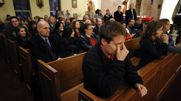 Mourners gather for a vigil service for victims of the Sandy Hook Elementary School shooting at St. Rose of Lima Roman Catholic Church in Newtown, Conn., on Friday night. (AP)