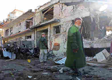 Afghan forces keep watch at the site of a bomb blast near a guesthouse in Kabul on Dec. 15.