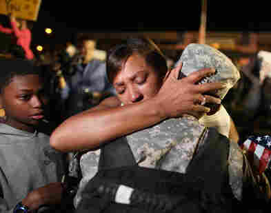 Army Sgt. Donald Lewis of the 1st Cavalry Division is greeted by his wife, Nicole Lewis, after his brigade arrived home from a year of deployment in Iraq on Nov. 10 in Fort Hood, Texas.