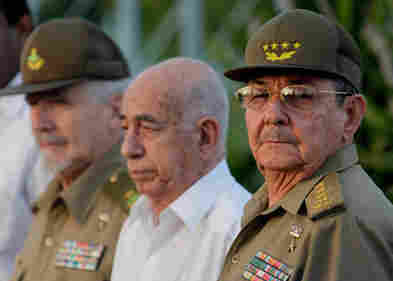 Cuba's President Raul Castro (far right), Vice President Jose Ramon Machado Ventura and Revolutionary Commander Ramiro Valdes attend a rally in July.