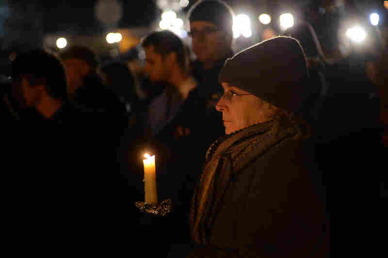 People gather for a prayer vigil at Saint Rose of Lima church in Newtown, Conn., on Friday.
