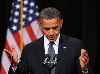 President Obama speaks at an interfaith vigil for the shooting victims from Sandy Hook Elementary School on Sunday at Newtown High School in Newtown, Connecticut.