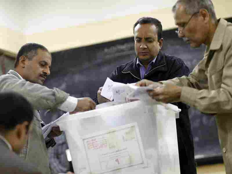 Polling station officials count ballots in Cairo on Dec. 15, at the end of the first day of vote in a referendum on a new constitution.