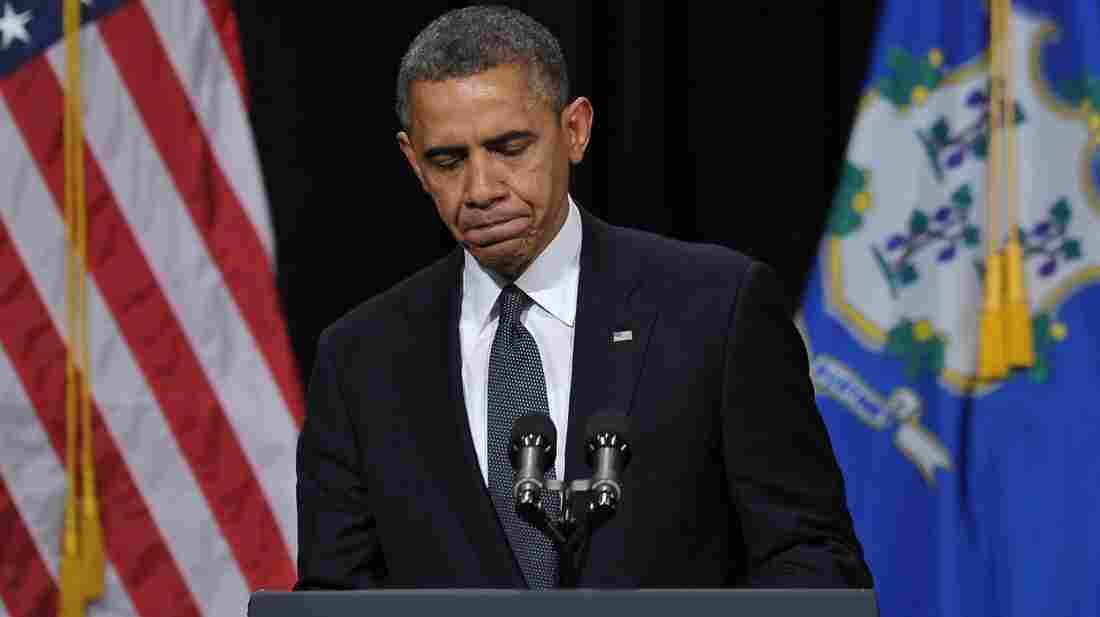 """President Barack Obama speaks at a memorial service for victims of the Sandy Hook Elementary School shooting. """"I come to offer the love and prayers of a nation,"""" he told the crowd in Newtown, Conn., Sunday."""