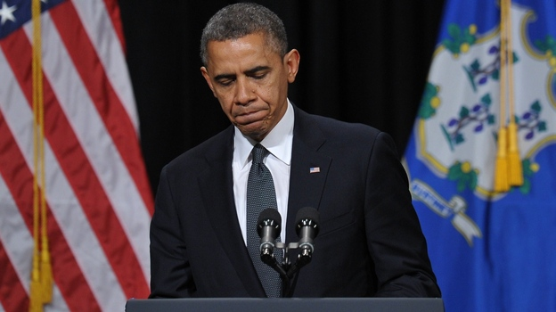 """President Barack Obama speaks at a memorial service for victims of the Sandy Hook Elementary School shooting. """"I come to offer the love and prayers of a nation,"""" he told the crowd in Newtown, Conn., Sunday. (AFP/Getty Images)"""