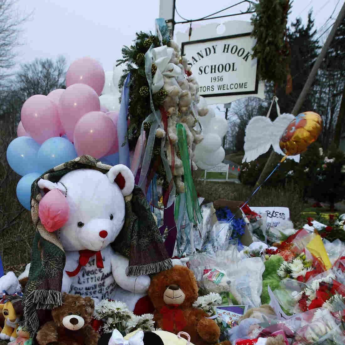 A makeshift memorial was set up near the entrance to the Sandy Hook Elementary School on Sunday.