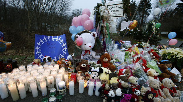 A makeshift memorial was set up near the entrance to the Sandy Hook Elementary School on Sunday. (Reuters/Landov)