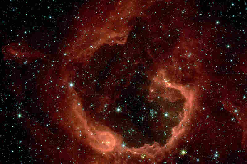 """""""This bubble of ionized gas and warm dust, called RCW 79, lies in the southern Milky Way. ... [NASA's telescopes] have found at least three generations of stars forming in this expanding envelope."""""""