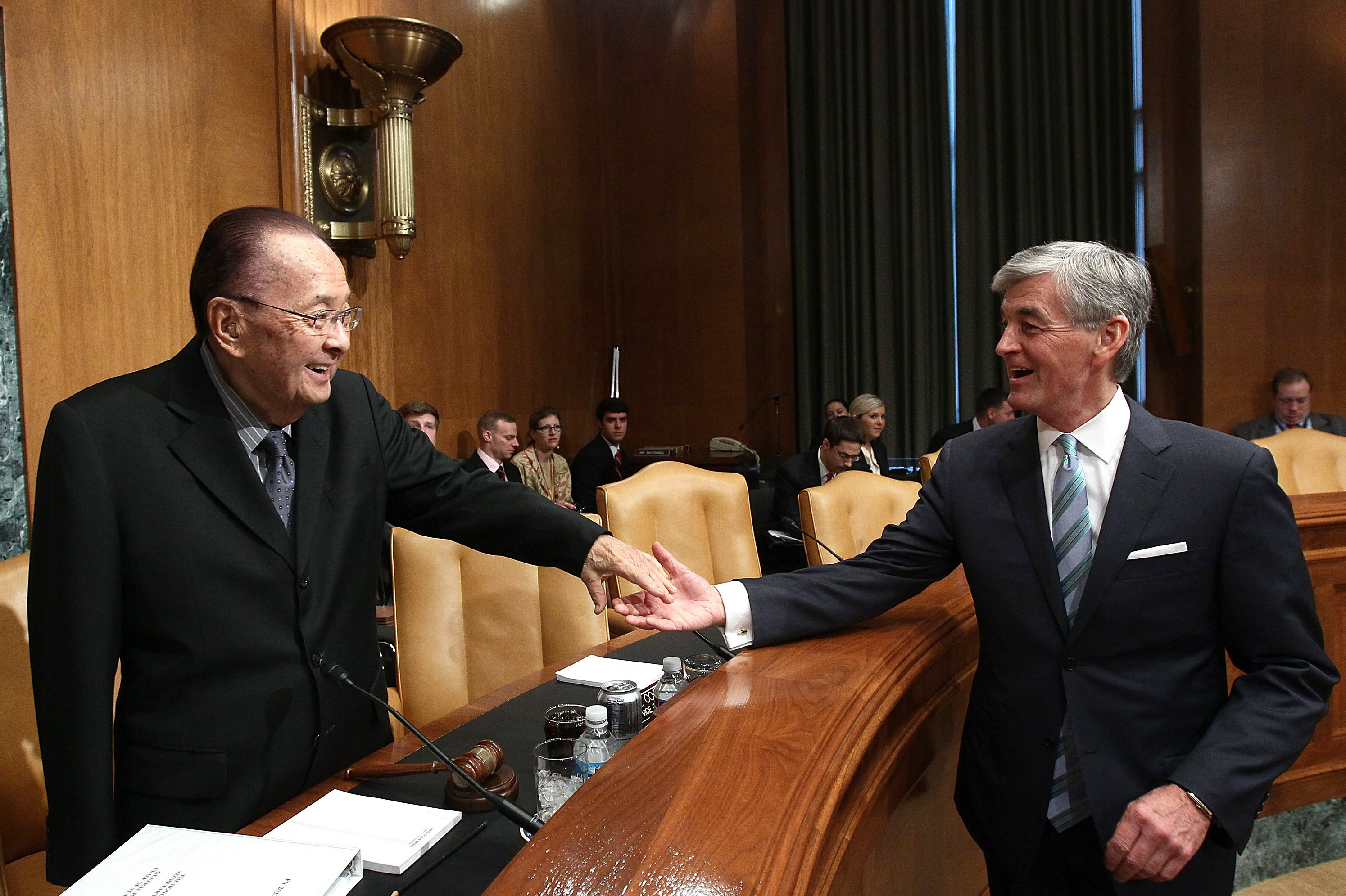 Secretary of the Army John McHugh greets Inouye before a hearing of the Senate Appropriations Committee March 21 in Washington, D.C.