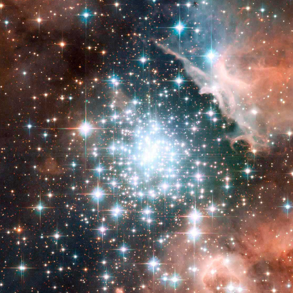 """Thousands of sparkling young stars are nestled within the giant nebula NGC 3603, one of the most massive young star clusters in the Milky Way Galaxy."""