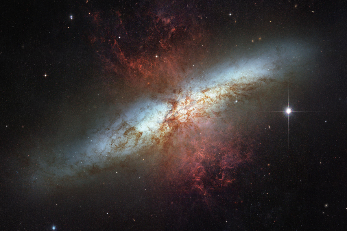 """Throughout the center of the Messier 82 starburst galaxy, """"young stars are being born 10 times faster than they are inside our entire Milky Way Galaxy."""""""