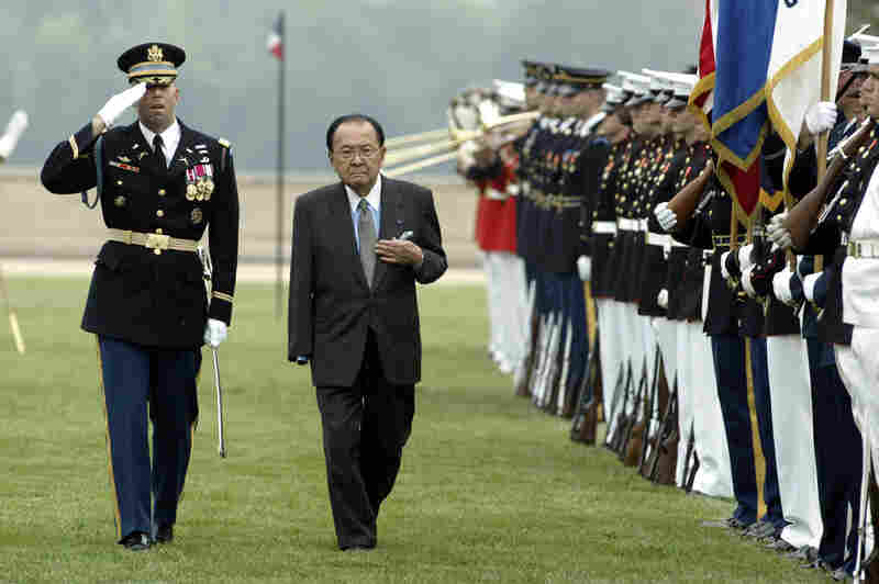 Inouye, escorted by Army Gen. Charles Taylor, inspects the troops outside the Pentagon during the annual National POW/MIA Recognition Day ceremony Sept. 14, 2004. Inouye lost his arm in World War II combat.