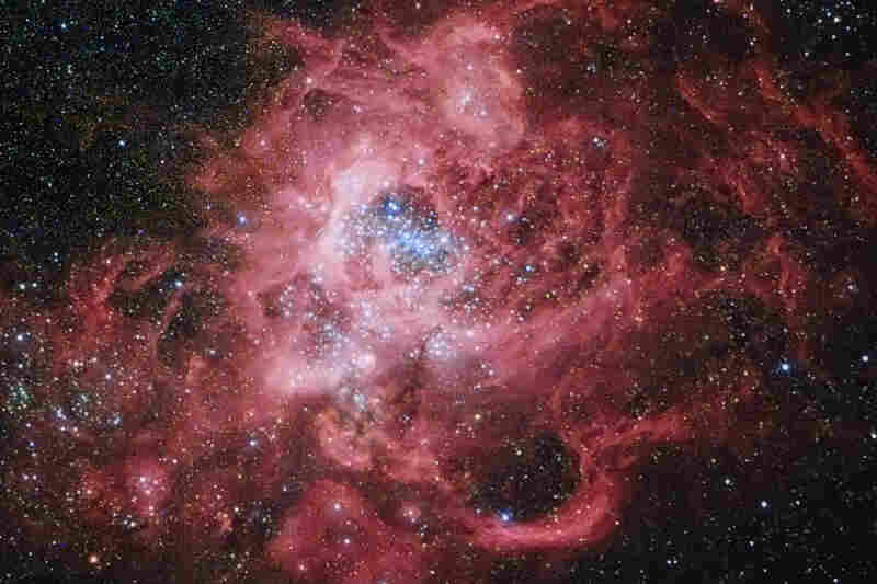 """""""Stars are sometimes born in the midst of chaos,"""" reads NASA's caption for this image of nearby galaxy M33."""
