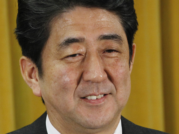 Liberal Democratic Party President Shinzo Abe smiles during a news conference at party headquarters in Tokyo on Monday, a day after the party's landslide victory in parliamentary elections.
