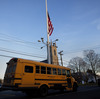 Friday afternoon: As a bus took some students home in Newtown, Conn., the flag was already at half-staff to honor the first-graders and school staff killed that morning.