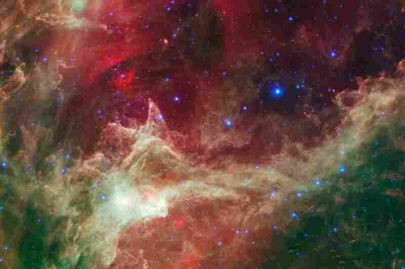 """""""In this wispy star-forming region, called W5, the oldest stars can be seen as blue dots in the centers of the two hollow cavities. ... Younger stars line the rims of the cavities, and some can be seen as pink dots at the tips of the elephant-trunklike pillars."""""""