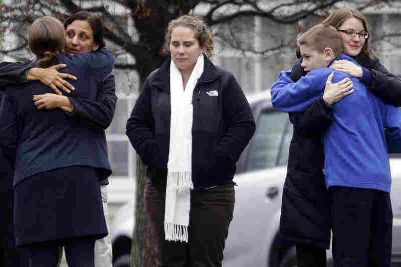 Mourners gather outside the funeral service of Jack Pinto, 6, in Newtown. Monday was the first day of funerals for the victims.