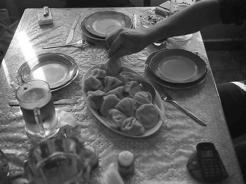 Eating lamb dumplings called khinkali at a table in Tbilisi, Georgia.