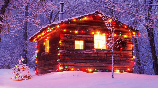 All Songs Considered hosts Bob Boilen and Robin Hilton rented a cabin in the woods for a special holiday party, with Kishi Bashi, Dan Deacon, Carrie Brownstein, and more as guests. (Getty Images)