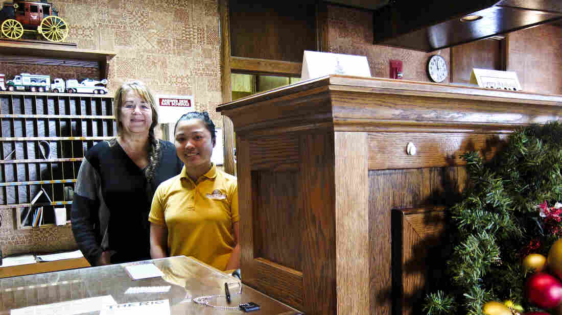 Cyndy Aafedt (left) owns the El Rancho hotel in Williston, N.D. Jobs in town have been hard to fill. Her employee, Mary Joy Hardt (right), who is from the Philippines, is one of many people with J-1 visas helping to fill retail, hotel and restaurant job openings here.
