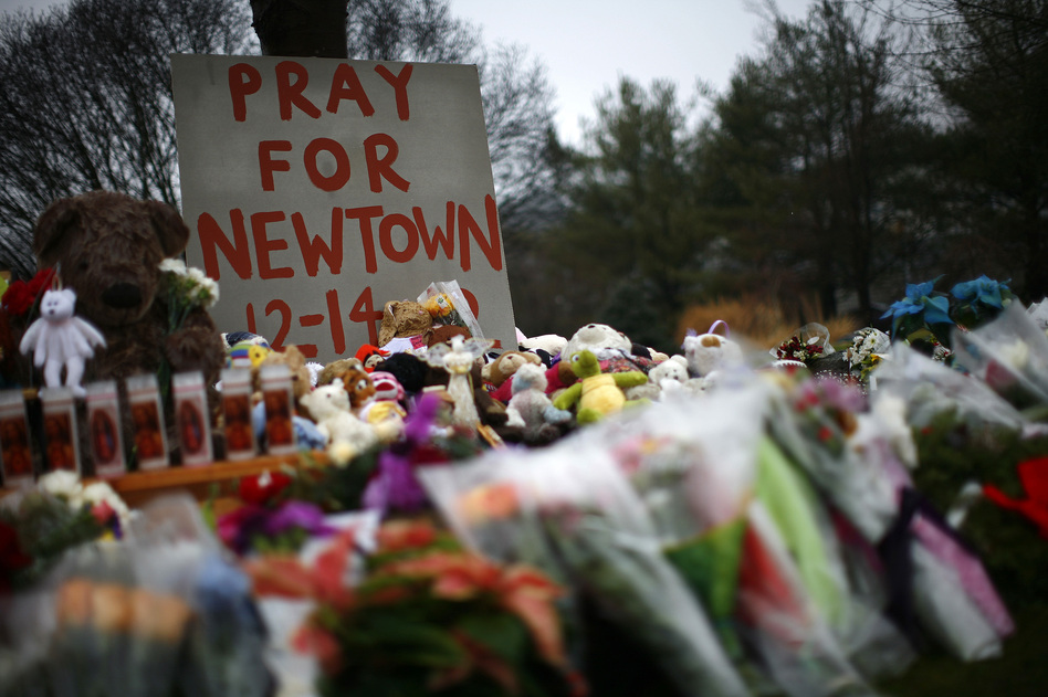 Flowers, candles and stuffed animals make up a makeshift memorial in Newtown, Conn., on Monday. Much of the initial news coverage of Friday's events was later found to be inaccurate. (Eric Thayer/Reuters/Landov)
