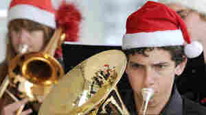 Members of the Victorian State Youth Brass Band of Australia during an attempt to set a world record by playing Christmas carols for 40 straight hours.