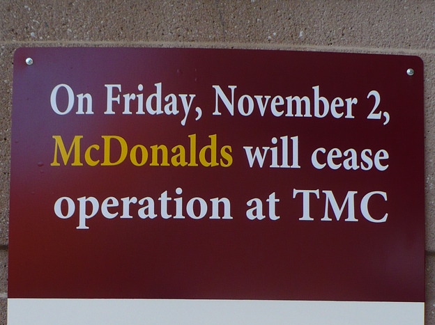 A sign outside an entrance at the Truman Medical Centers' main campus in Kansas City, Mo., announces the closure of the McDonald's located on-site.