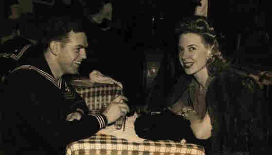 "Creore sits with a sailor at the Stage Door Canteen in New York. ""They were all homesick,"" she recalls."