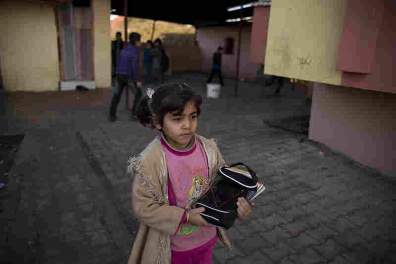 Maysam Selmo, 8, during her first week at Albashayer School for Syrian Refugee Children in Antakya, Turkey. She and her extended family fled their village in northwestern Syria and now live in a crowded apartment.