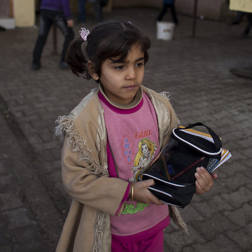 Maysam Selmo, 8, during her first week at Albashayer School for Syrian Refugee Children in Antakya, Turkey. She and her extended family fled their village in northwestern Syria, and now live in a crowded apartment.