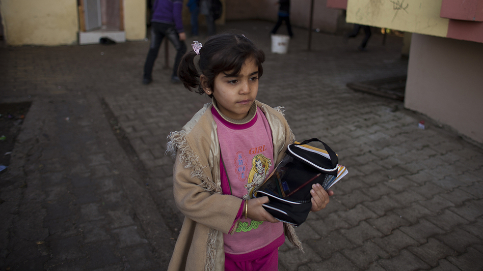 Maysam Selmo, 8, during her first week at Albashayer School for Syrian Refugee Children in Antakya, Turkey. She and her extended family fled their village in northwestern Syria, and now live in a crowded apartment. (Jodi Hilton for NPR)