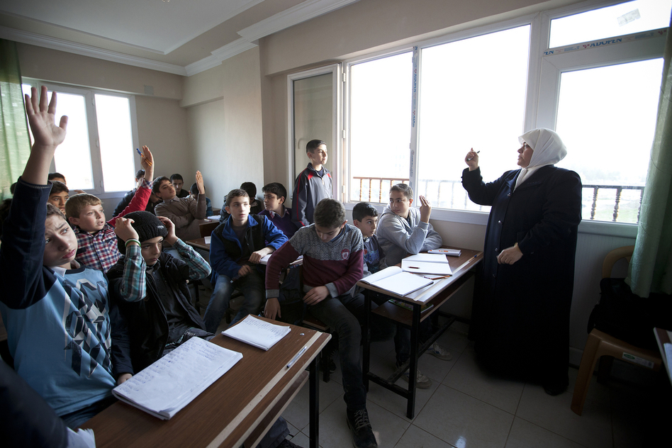 Teacher Emine Kusa leads a Turkish class for eighth-graders. Albashayer opened nearly two years ago when refugees began arriving in southern Turkey. A second building was recently opened to accommodate the growing number of students. (Jodi Hilton for NPR)