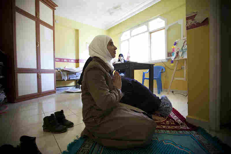 Teachers at the school are mostly devout Muslims. Between classes, teachers Rahaf Al Tinawie and Rola Kadi take a break to pray.