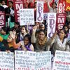 Indian women and children in New Delhi stage a protest Tuesday to condemn the gang rape of a 23-year-old student on a city bus.
