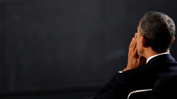President Obama attends a vigil for the Sandy Hook Elementary School shooting victims on Sunday in Newtown, Conn.