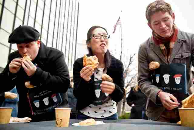 First Stop: Pastry Eating Contest. News Apps Developer Jeremy Bowers, Mobile Product Manager Jen Oh and Digital Media Intern Curtis Bard kick the race off as they make their way through four pastries. Apparently some NPR staffers are better at savoring their food than scarfing it down: mid-way through, the requirement for completing this challenge was reduced to just two pastries.