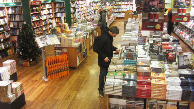 A shopper browses in a branch of the Icelandic book chain Penninn-Eymundsson.