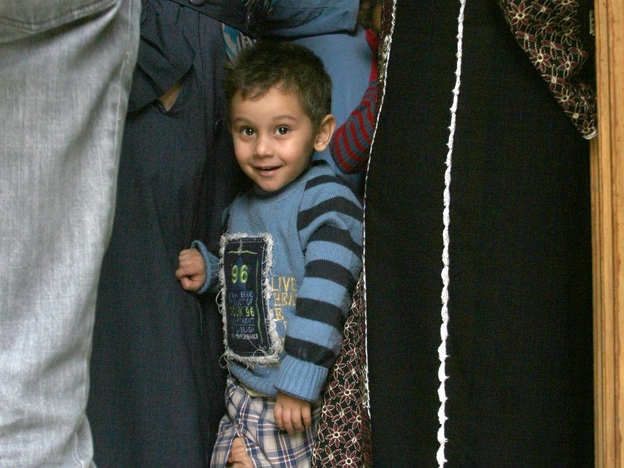 The family of this Palestinian boy was among many that fled the Yarmuk refugee camp near the Syrian capital Damascus after fighting in recent days. The boy and his family are shown at another refugee camp, this one in the Lebanese city of Tripoli, on Tuesday. (AFP/Getty Images)