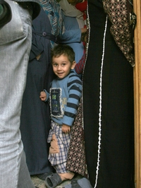 The family of this Palestinian boy was among many that fled the Yarmuk refugee camp near the Syrian capital Damascus after fighting in recent days. The boy and his family are shown at another refugee camp, this one in the Lebanese city of Tripoli, on Tuesday.