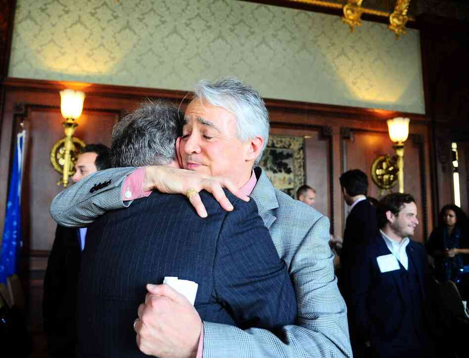 Following the Military Voices launch event, NPR Weekend Edition Saturday host Scott Simon hugs Gordon Bolar, General Manager of NPR Member Station WMUK in Kalamazoo, Michigan. In 2007, Bolar's son Matthew was killed by a roadside bomb in Iraq.