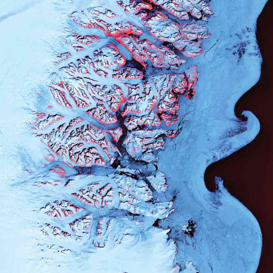 Ice Waves, Greenland, 2001The undulating swirls shown here along the eastern coast of Greenland are slurries of sea ice, newly calved icebergs, and older weathered bergs. During the summer melting season, the southward-flowing East Greenland Current twirls these mixtures into stunning shapes. The exposed rock of mountain peaks are tinted red.