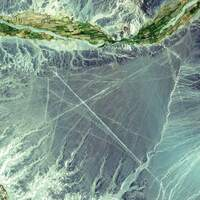 <p><strong>Nazca Lines, Peru, 2000</strong></p><p>The ancient geoglyphs, located in southern Peru, are estimated to be created by the Nazca culture between 400 and 650 A.D. The Nazca Lines were made by removing reddish iron-oxide pebbles that cover the surface of the desert. When the gravel is removed, the lines contrast with the light color underneath.</p>