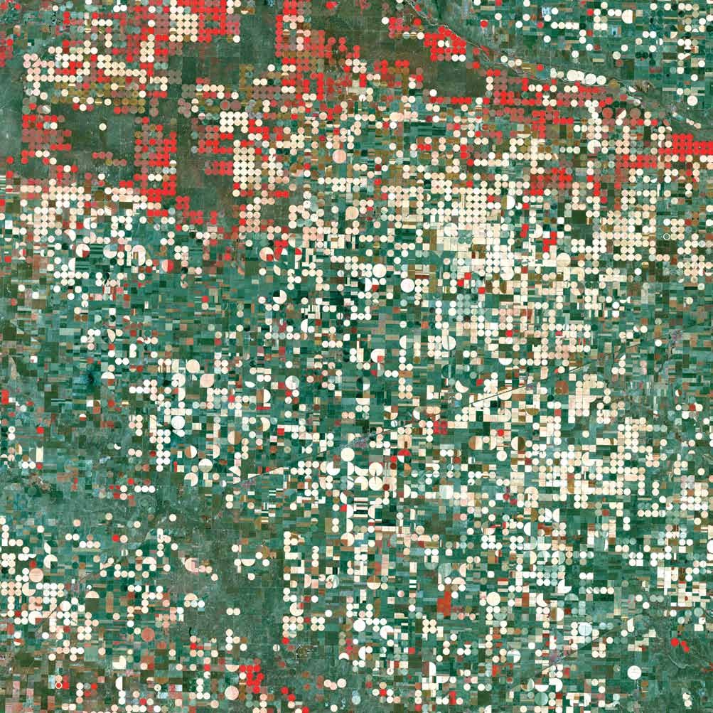 Garden City, Kan., U.S., 2000Garden City, Kan., has a semi-arid steppe climate with hot, dry summers and cold, dry winters. Center-pivot irrigation systems created the circular patterns. The red circles indicate irrigated crops of healthy vegetation, and the light-colored circles denote harvested crops.