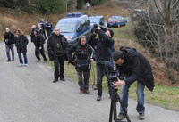 French journalists film the Pic of Bugarach, a mountain in the village that is said to have magical powers.